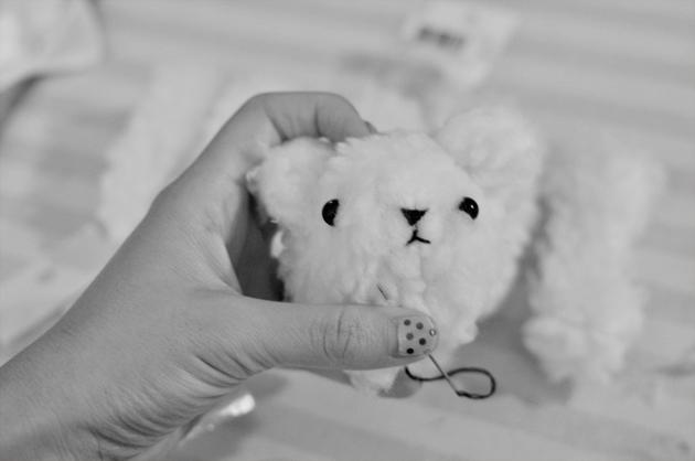 Attaching eyes to teddy bear