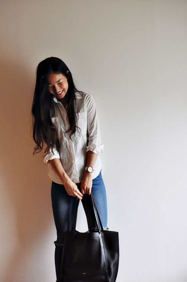 white-button-up-blue-jeans-black-leather-tote