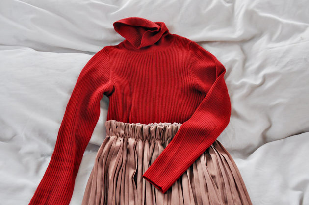 red turtle neck and pleated skirt